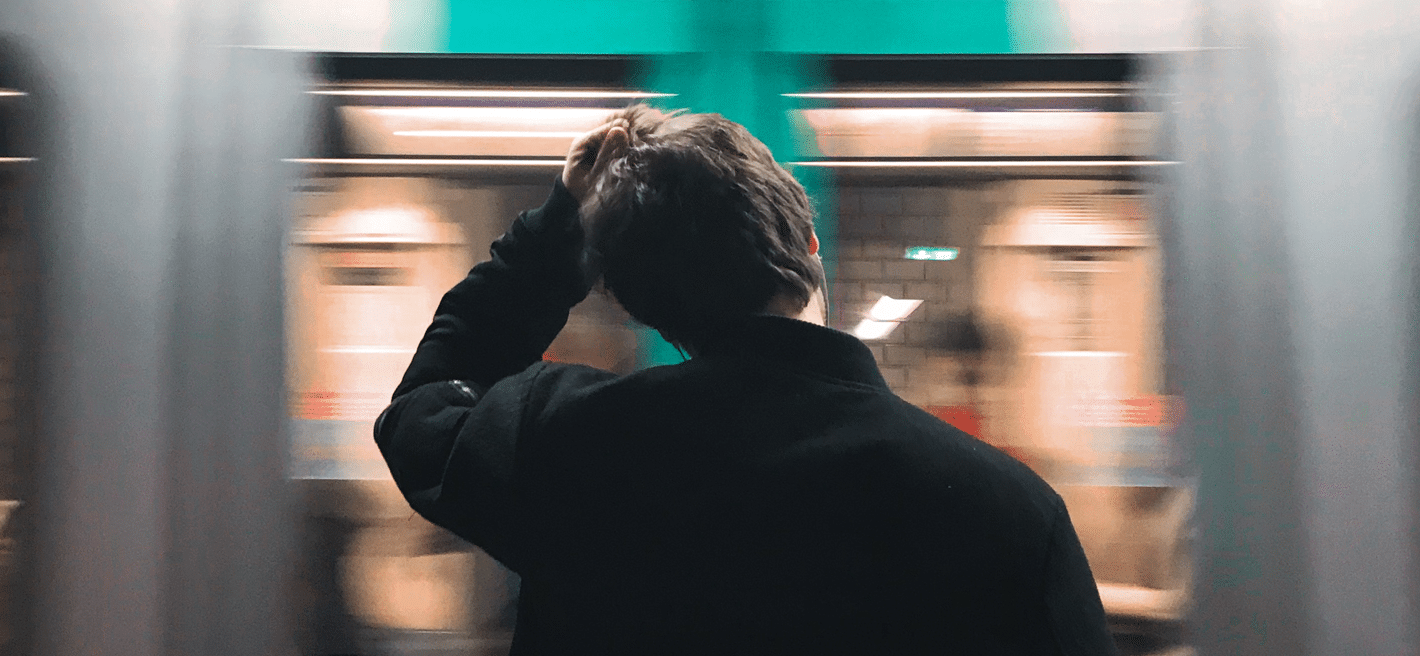 Confused man standing at the subway in France